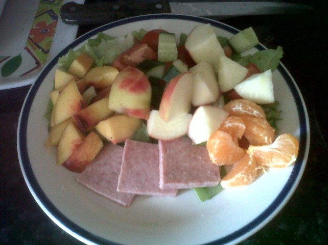 Salad with cooked meat and some fruit added in to make it taste different